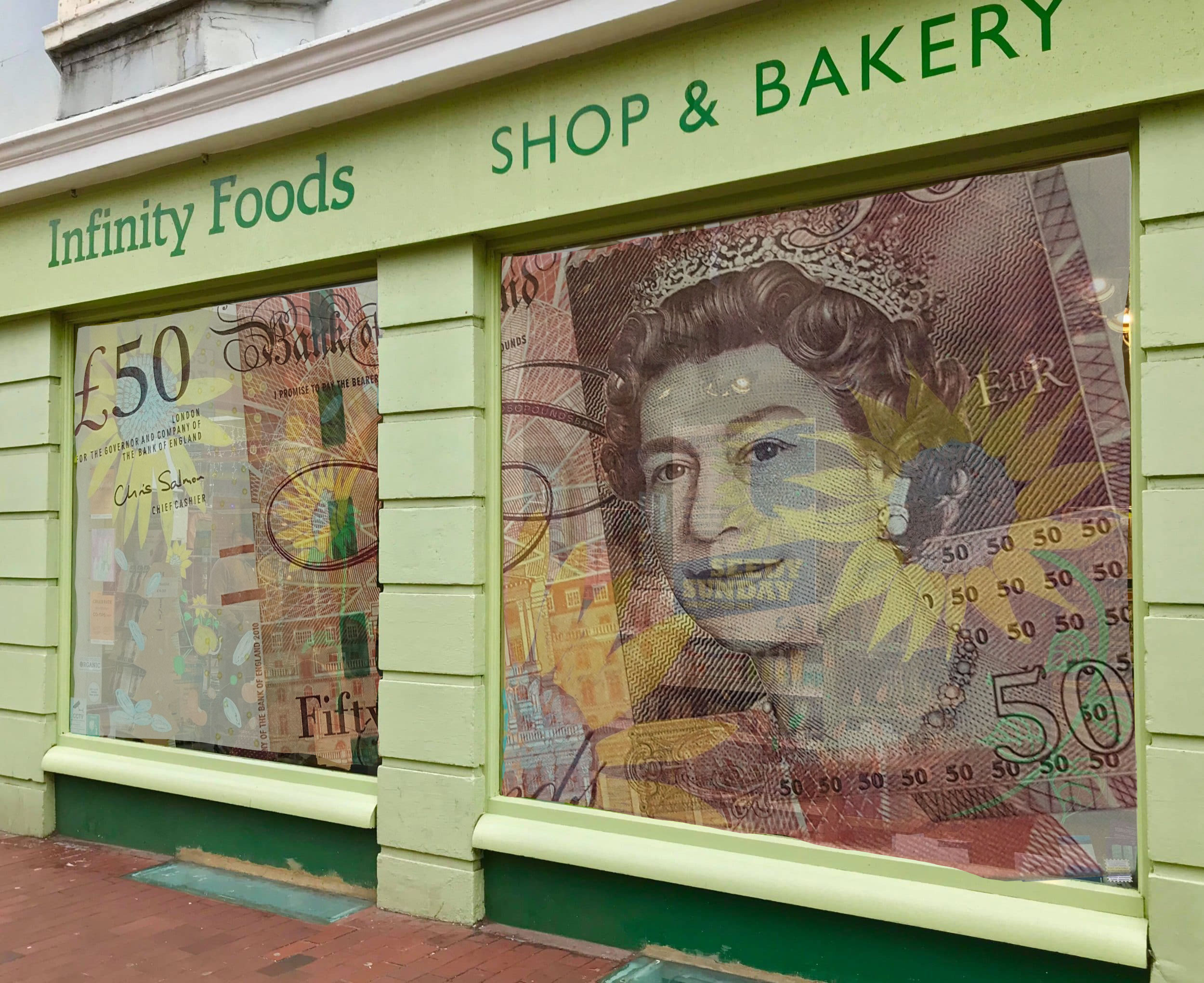 image of shop with £50 note super imposed in window